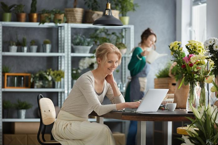woman in flower shop on laptop